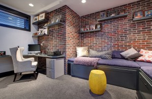 Contemporary-basement-home-office-with-a-brick-wall